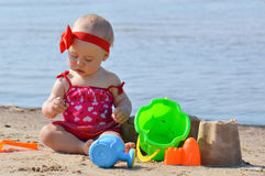 Baby with sand toys Royalty Free Stock Image