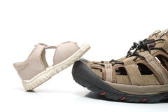 Free Baby Sandal Stepping On Adult Shoe, Isolated Stock Photography - 5882492