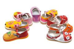 Baby sandals exposed by semicircle Royalty Free Stock Images