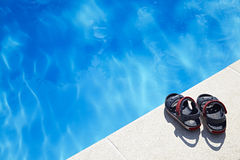 Baby sandals at the swimming pool Royalty Free Stock Images