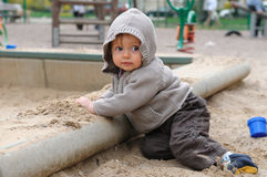 Baby on the sandpit royalty free stock images