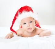 Baby in santa cap Stock Image