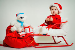 Baby santa with Christmas gifts Royalty Free Stock Photo