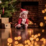 Baby Santa Claus celebrates Christmas royalty free stock photo
