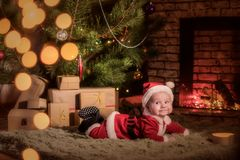 Baby Santa Claus celebrates Christmas royalty free stock photos