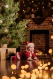 Baby Santa Claus celebrates Christmas stock photography
