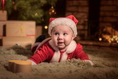 Baby Santa Claus celebrates Christmas stock image