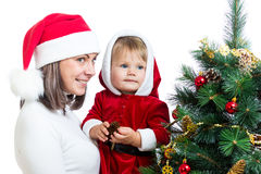 Baby in Santa Claus clothes and mother isolated Stock Photography