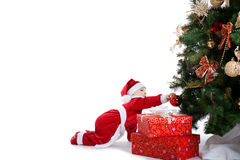 Baby santa claus decorate fir tree Royalty Free Stock Photography