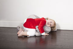 Baby santa claus embraced plush doll Stock Photo