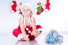 Baby Santa Claus with garlands of Christmas bootee. Cute baby Santa Claus with garlands of Christmas bootee Stock Image