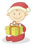 Baby Santa Claus with a gift box Stock Photography