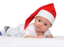 Baby in the Santa Claus Hat. Baby in the christmas cap Stock Image