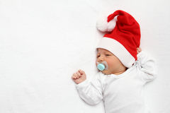 Baby with Santa Claus hat Stock Images