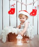 Baby  in a santa claus hat. Cute baby in a santa claus hat close-up Royalty Free Stock Photography