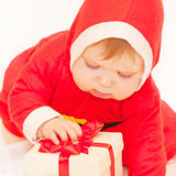 Baby Santa Claus holding Christmas gift Stock Photo