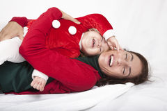 Baby santa claus laughing with mother Royalty Free Stock Photo