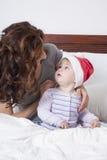 Baby Santa Claus and mom Royalty Free Stock Photo