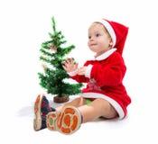Baby Santa Claus. Near Christmas tree on white background Stock Photo