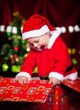 Baby in Santa costume Stock Photo