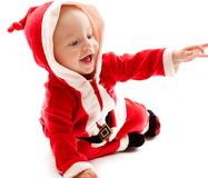 Baby in santa-costume Stock Photo
