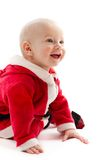 Baby in santa-costume Stock Images