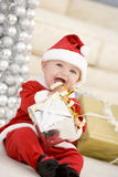 Baby In Santa Costume At Christmas Royalty Free Stock Photos
