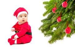 Baby in Santa costume Stock Image