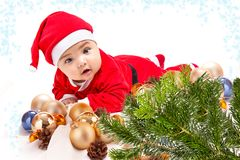 Baby in Santa costume Royalty Free Stock Images