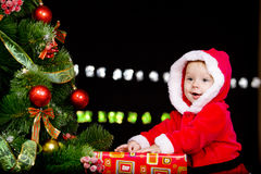 Baby in Santa costume over black Stock Images