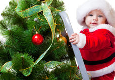 Baby in Santa costume on a step ladde Royalty Free Stock Photo