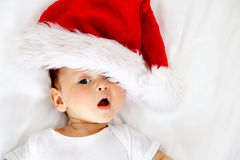 Baby with Santa hat Stock Images