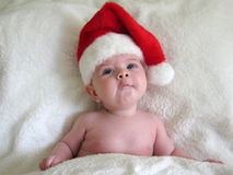 Baby with santa hat. Funny little baby with santa hat on for Christmas Stock Images