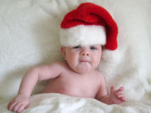 Baby with santa hat. Funny little baby with santa hat on for Christmas Stock Photos