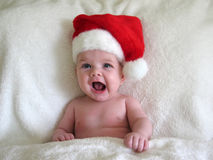 Baby with santa hat. Funny little baby with santa hat on for Christmas Royalty Free Stock Photo