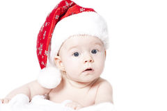 Baby with Santa hat isolated on white Stock Photos
