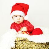 Baby in Santa hat, New Year Stock Photos