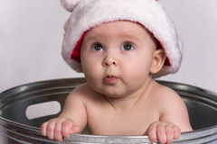 Baby with Santa Hat sitting in Wash Basin Stock Photography