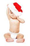 Baby-Santa with red Christmas hat Stock Photo