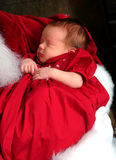Baby in Santa's Arms Stock Photo