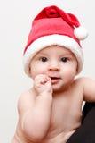 Baby in santa's cap. Baby in santa claus cap Royalty Free Stock Images