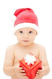 Baby in santa's cap with gift Stock Images