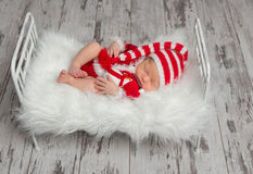 Baby in Santa`s costume with a snowman Stock Photo