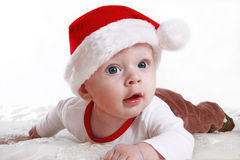 Baby in Santa's hat. Beautiful christmas santa baby boy wearing a santa's hat. Isolated on white stock photography