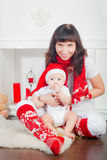 Baby in Santa's Hat And His Mother Stock Photos