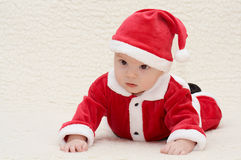 Baby in santa's suit. Baby in santa claus suit royalty free stock images