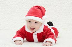 Baby in santa's suit. Laughing baby in santa's suit royalty free stock images