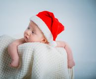 Baby in a santa suit. Royalty Free Stock Photo