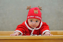 A baby in a Santa suit Stock Photos