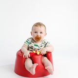 Baby sat in cosy chair Stock Image
